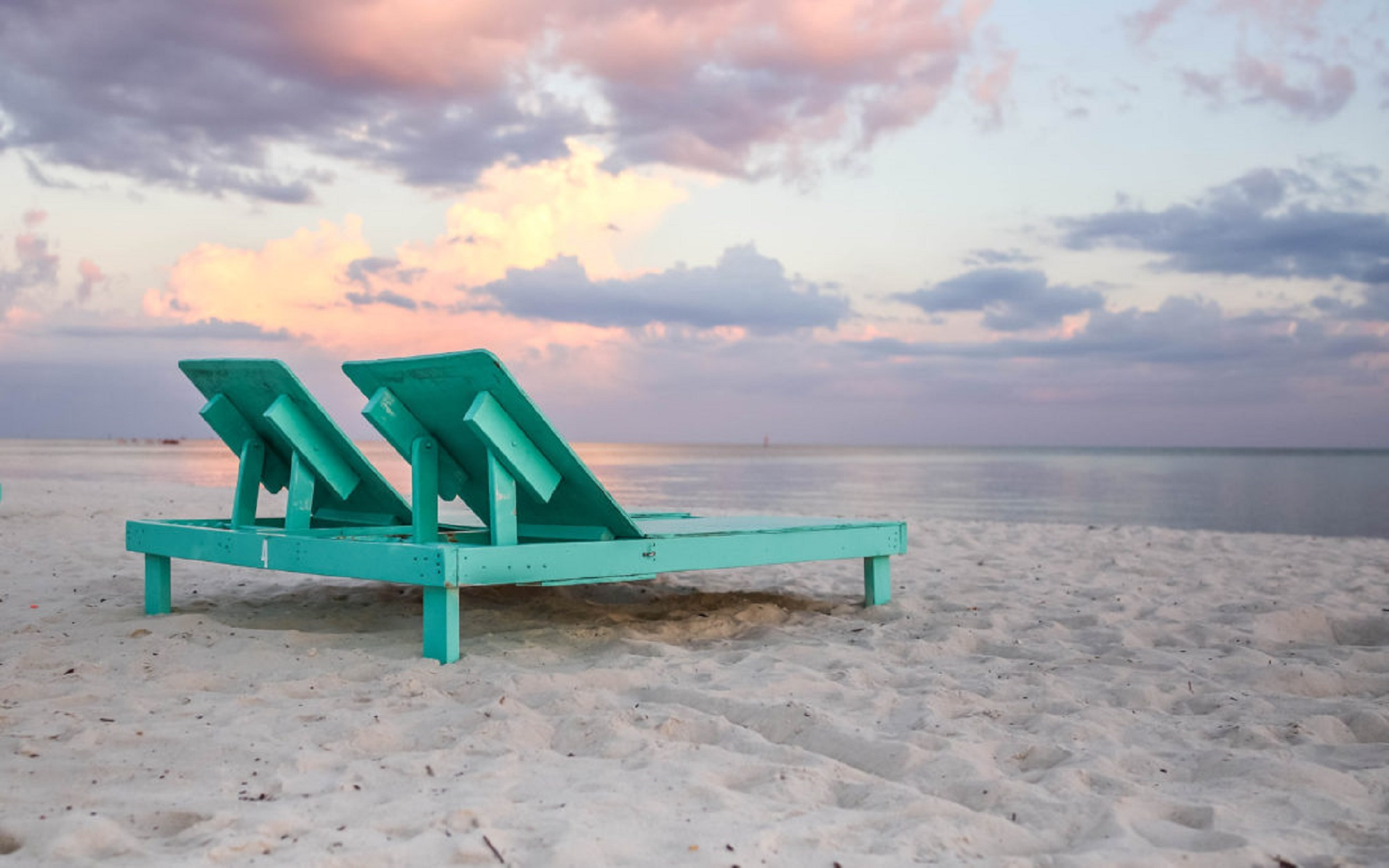 Beach chairs on a sunset beach