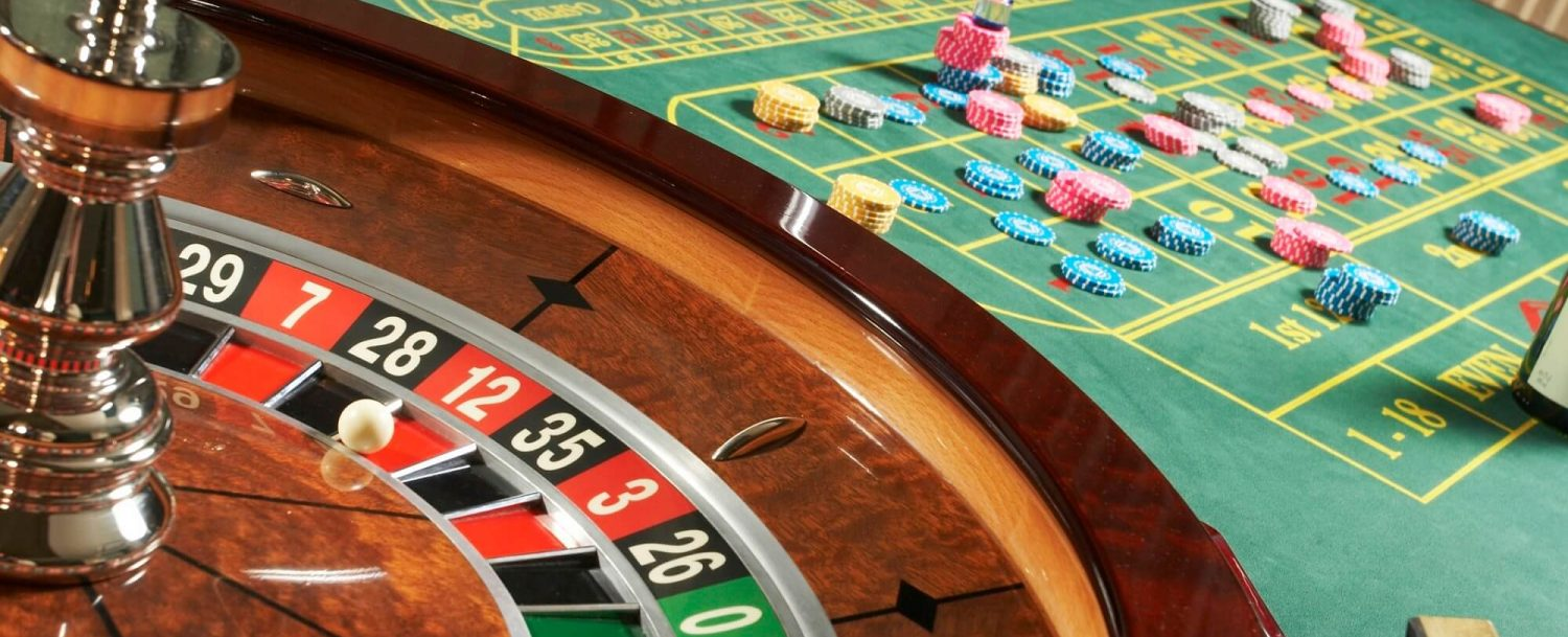 Casino table and roulette wheel