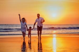 family on beach in sunset